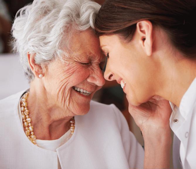 senior woman smiling at nurse